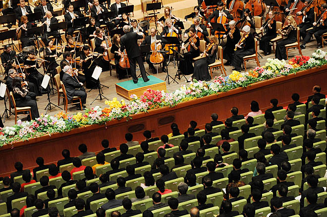 "Members of the North Korean audience listen to the New York Philharmonic orchestra led by Musical Director (conductor) Lorin Maazel during their inaugural performance in the North Korea capital, Pyongyang on February 26, 2008.  The concert represents an unprecedented cultural exchange between North Korea and the United States, which labeled Pyongyang part of the ""Axis of Evil"" along with Iran and Iraq, prior to the US-led 2003 war.     AFP PHOTO/Mark RALSTON (Photo credit should read MARK RALSTON/AFP/Getty Images)"